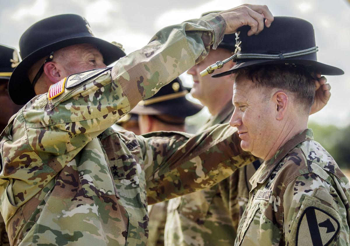 Matthew J. Van Wagenen a 1st Cavalry Division stetson during the patch and  retreat ceremony Monday at Fort Hood s Cooper Field. b2a14a3ec37