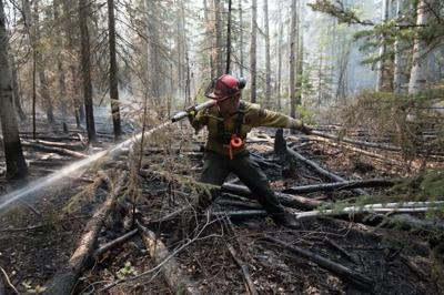 Wildfires have forced more than 9,000 people from homes in northern Alberta