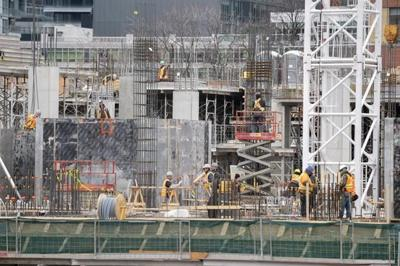 Ontario's tighter rules allow builders to keep working on condos, other jobs