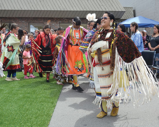 First Nations members dance