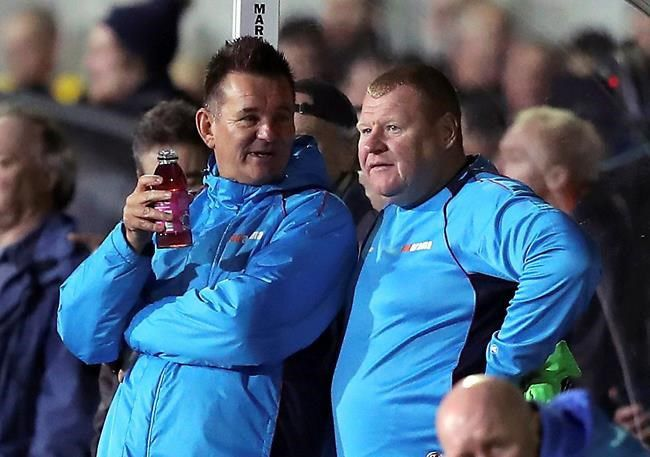 Pie eating goalie Wayne Shaw handed two month ban