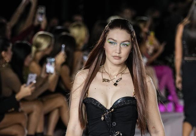 Dua Lipa walks the Versace runway, Prada resists normality