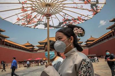China boosts spending for virus-hit economy, takes up HK law