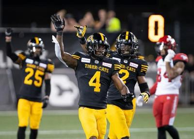 Brandon Banks scores three touchdowns to lead Ticats past Stampeders 30-23