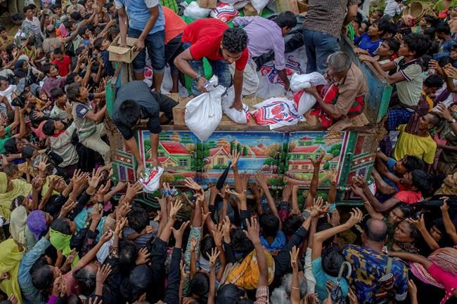 Thousands protest in Bangladesh as Rohingya flee Myanmar
