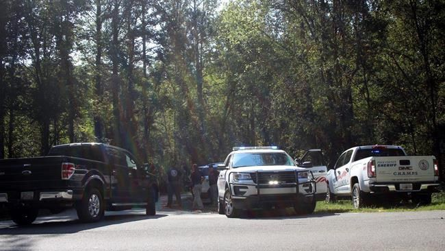 Two officers shot one dead in Polk County; suspect at large