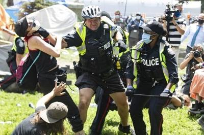 Homeless supporters, authorities clash as Toronto clears another homeless encampment