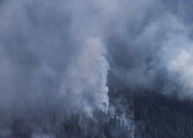 Firefighters battle wildfire east of Kelowna- Highway 33 closed