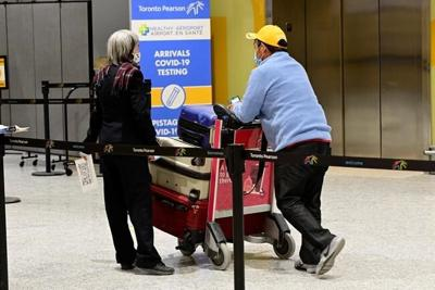 Stricter public health measures come into effect at Canadian borders, airports
