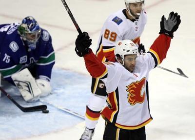 Virtanen scores OT winner as Canucks rally over Flames in pre-season