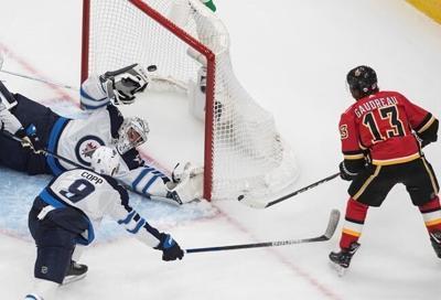 Flames ground Jets 4-1 to take series lead, Winnipeg's Scheifele injured