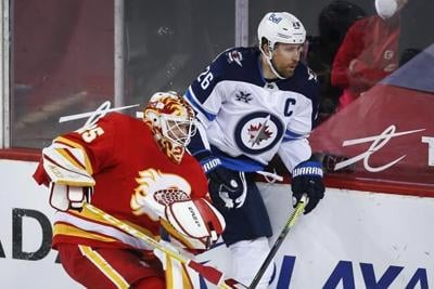 Winnipeg Jets treating captain Blake Wheeler's injury as a concussion