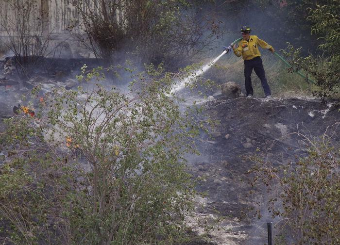 Firefighters put out one grass fire, second one starts