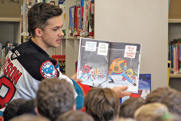 Rockets read to students