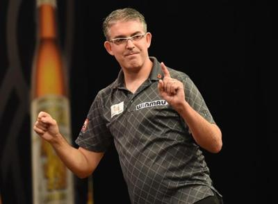 Canadian darts pro in self-isolation after earning his way back on tour