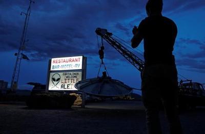The Latest: 1 arrest, 1 detained at alien festival in desert