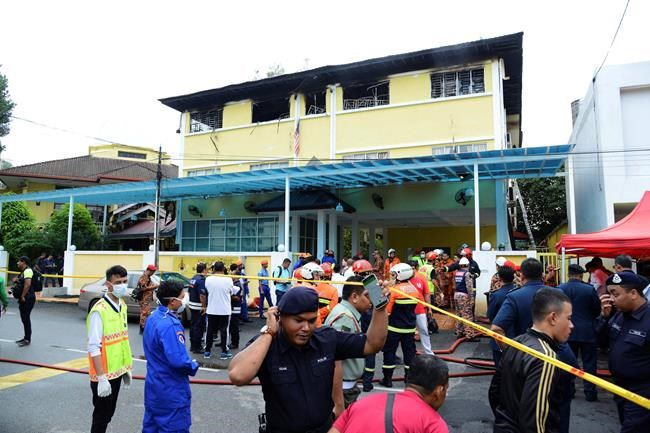 Fire blocks lone exit to Malaysian school dormitory 23 dead