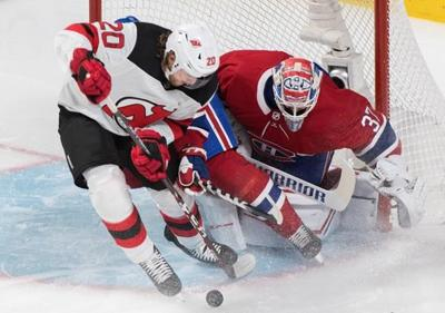OT hero Palmieri helps Devils complete comeback victory over Canadiens