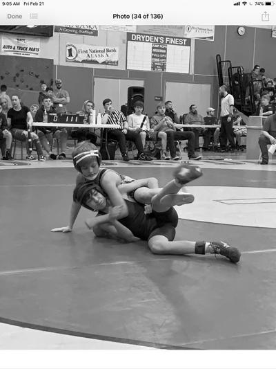 Titan Linne holds down opponent
