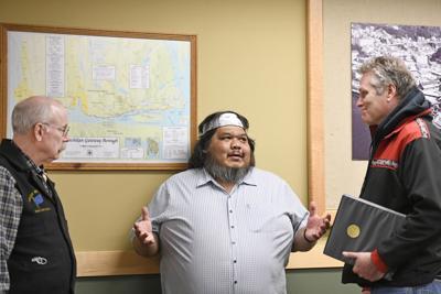 Mayor Frank Seludo talks to Gov. Mike Dunleavy and Sen. Bert Stedman