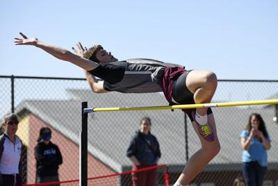 Jared Rhoads competes in the high jump