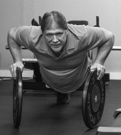 John West demonstrates a plate push up