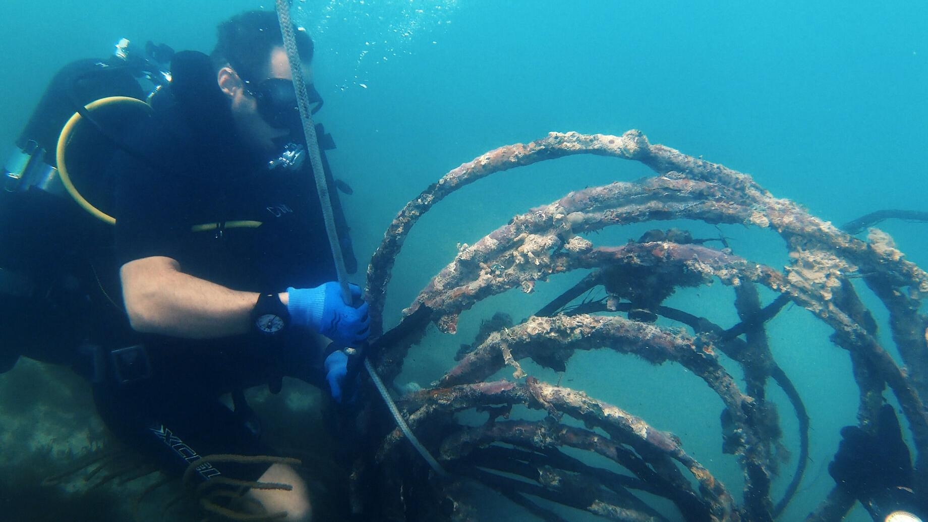 Military divers wage war on trash