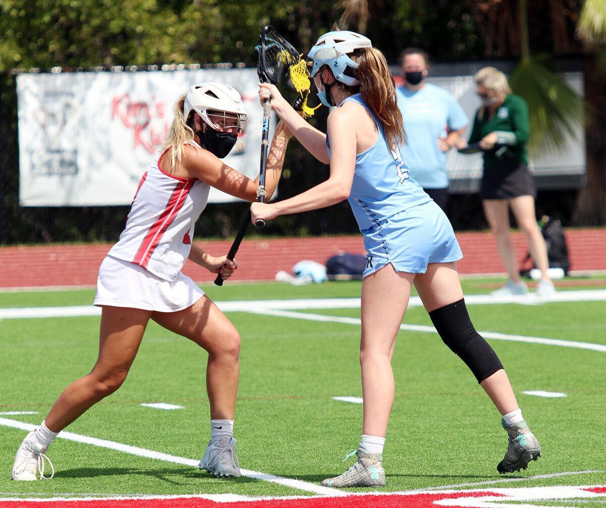 2021.04.07 prep girls lacrosse mcmonigle faceoff.jpg
