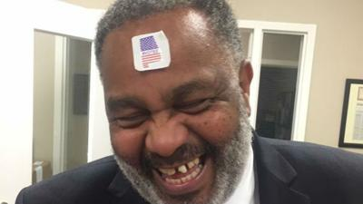 Thousands share photo of ex-inmate with #VOTED sticker