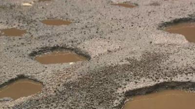 Costs of Spokane's potholes adding up