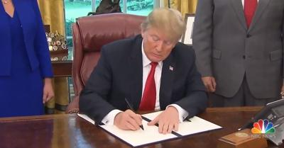 Trump signs order stopping policy of separating families at border