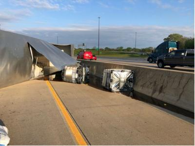 Semi-trailer hauling honey overturns along Indiana highway