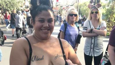 Photo of mom breastfeeding while in line at Disneyland sparks debate