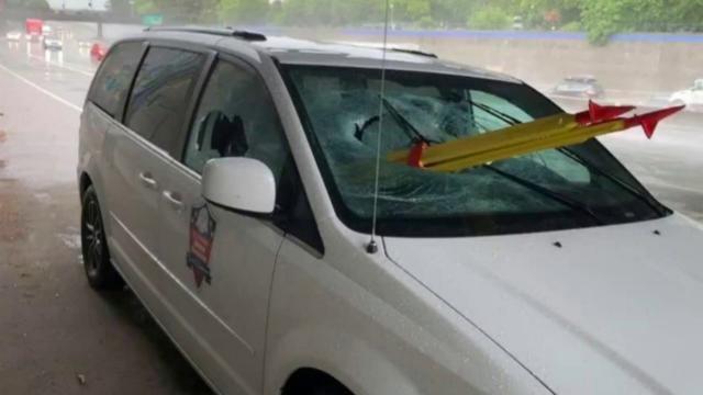 Stolen tripod thrown from overpass crashes through