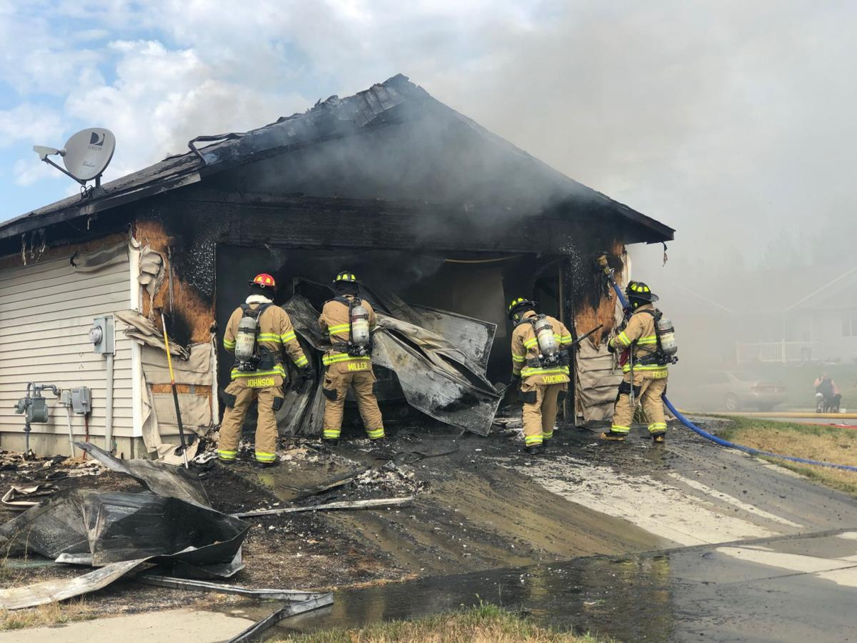 Two people displaced after Thursday morning garage fire in Post Falls