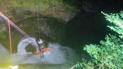 Woman who went over waterfall rescued after grabbing rock