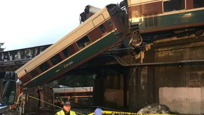 The Latest: 72 people taken to hospitals after derailment
