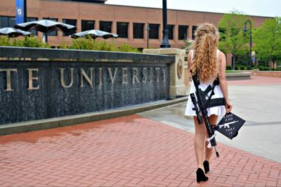 Photo of Kent State graduate carrying AR-10 on campus goes viral