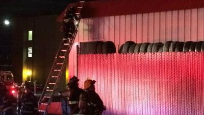 Crews quickly put out tire fire at Spokane Les Schwab