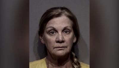 Wife of missing CdA boater arrested on suspicion of grand theft, forgery