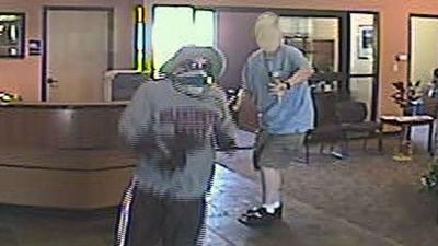 NEW PHOTOS: Spokane Valley bank robbery suspect shot by customer