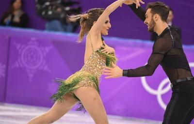 French ice dancer has wardrobe malfunction nightmare when top comes unhooked