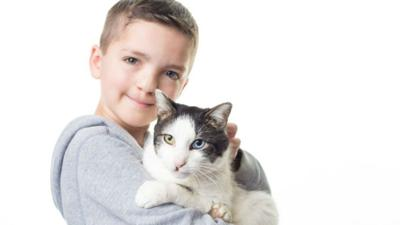 Bullied Oklahoma boy adopts cat with same rare eye condition, cleft lip