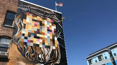 New mural by local artist garners reaction online