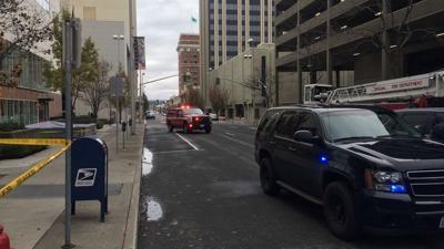 Pedestrian killed as car slams into building in downtown Spokane