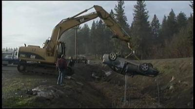 KHQ EXCLUSIVE: Airborne Car Lands Upside Down In Drainage