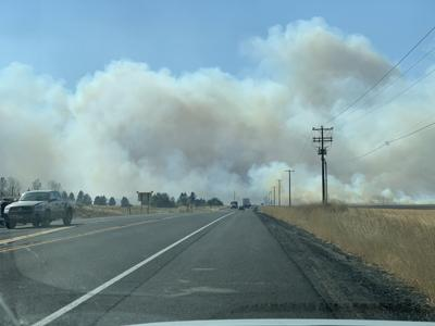 Fire burning near Highway 2, north of the Spokane Airport