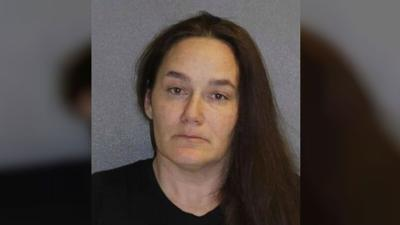 Florida woman arrested after 3 dogs found in freezer