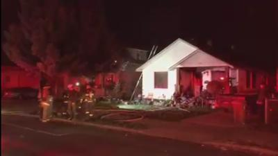 One firefighter suffers minor injuries after North Spokane house fire