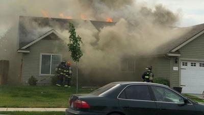 Neighbors report house fire while police respond to domestic violence call